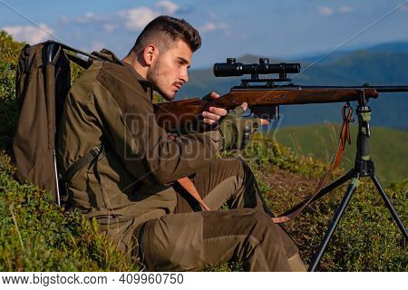 Man On The Hunt. Poacher In The Forest. Hunter With Shotgun Gun After A Hunt. Hunting Rifle. Guy Wit