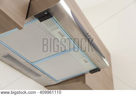 A Close-up On Under Cabinet Hood, Exhaust Vent Hood And Modern Electric Stove, Cooktop In Gray And W