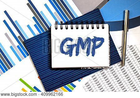 Notebook With Toolls And Notes About Gmp , Business Concept