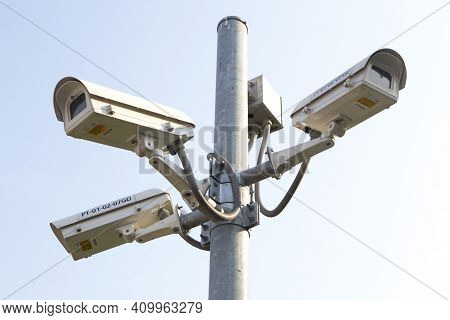 Cctv Camera Fixed On Metal Pole On City Street. Close-up. Concept Of Security.