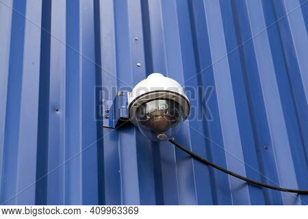 Outdoor Cctv Security Cameras Installed On The Modern Blue Building Wall In The City. Concept Of Sur