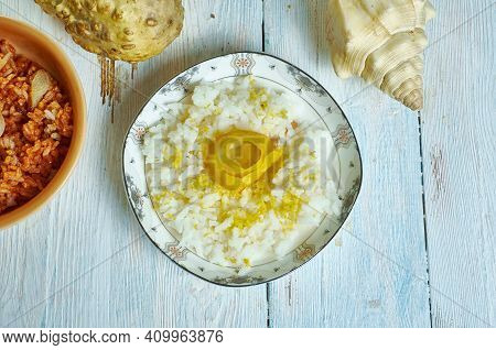 Risotto Al Limone - Lemon Risotto, Finished With Grated Parmigiano-reggiano And Served Hot.