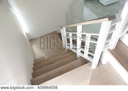 Modern Design White Wooden Stairs. Stairs And A Wooden Banister And Railing, Close-up.