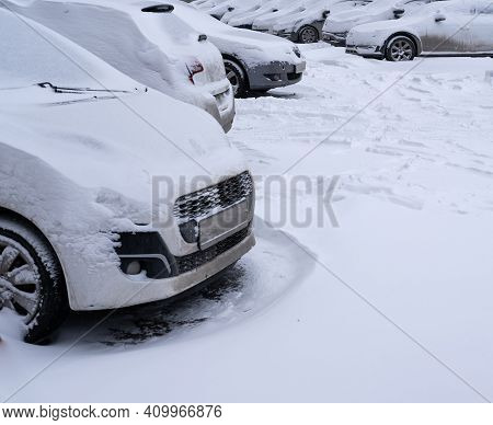 Cars Covered With Snow After Heavy Snowfall. Cars In Snowdrifts