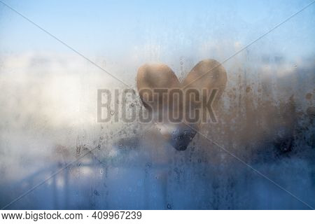 Heart Painted On Misted Glass. View From The Window To The Winter Sunny City. High Quality Photo