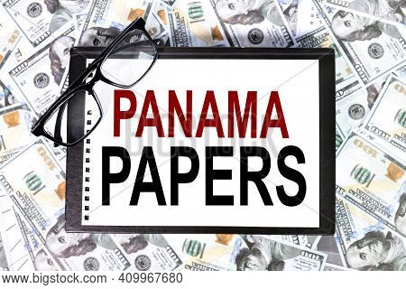Panama Papers. Text On White Paper On The Background Of Banknotes And Dollar Bills