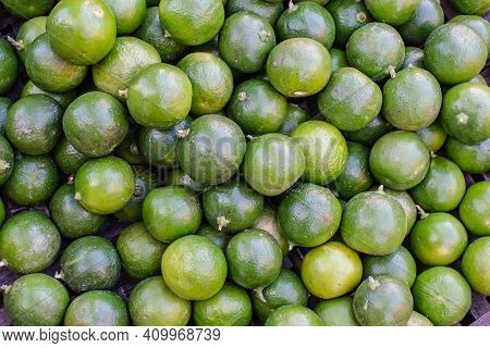 Background Of Fresh Green Limes Closeup, On Sale At Local Market.