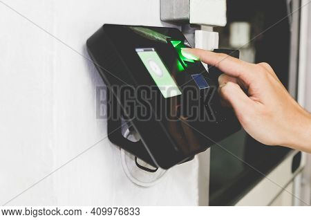 Side View Of Hand Scanning Fingerprint To Screening System Gain Entry Security To Building. Biometri