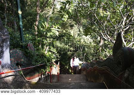 Travelers Thai Women Walking Up On Naga Serpent Stairway Go To Tham Muang On Cave Formerly Named Tha