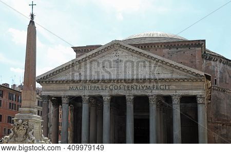 Entrance Of The Ancient Temple Called Pantheon And An Egyptian Obelisk In Rome In Italy