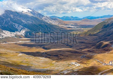 Breathtaking Landscape Of The Immense Valley In The Abruzzo Region In Central Italy In Summer Viewed