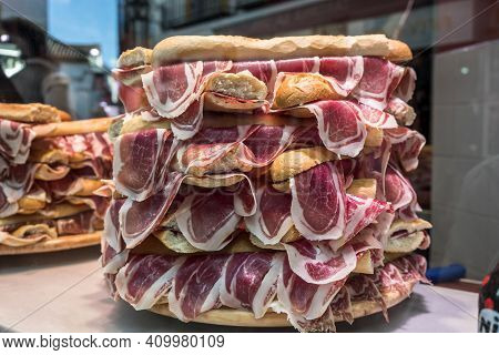 Several Jamon Serrano Sandwiches Piled Up In A Shop Window, Conceptual Image