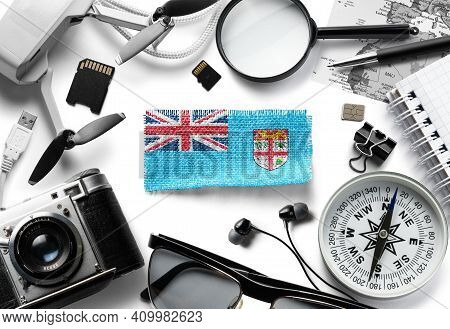 Flag Of Fiji And Travel Accessories On A White Background.