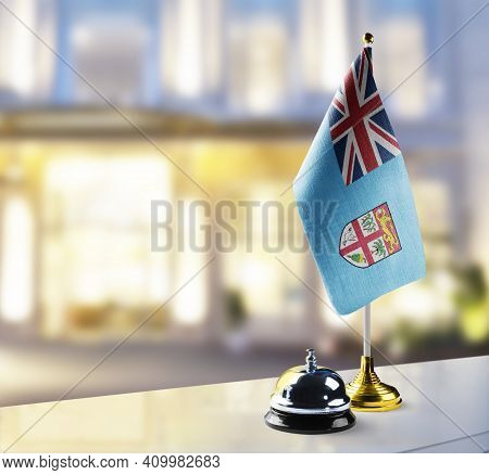 Fiji Flag On The Reception Desk In The Lobby Of The Hotel