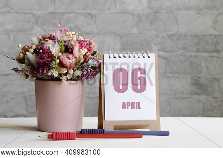 April 06. 06-th Day Of The Month, Calendar Date.a Delicate Bouquet Of Flowers In A Pink Vase, Two Pe
