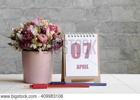 April 07. 07-th Day Of The Month, Calendar Date.a Delicate Bouquet Of Flowers In A Pink Vase, Two Pe