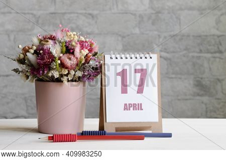 April 17. 17-th Day Of The Month, Calendar Date.a Delicate Bouquet Of Flowers In A Pink Vase, Two Pe