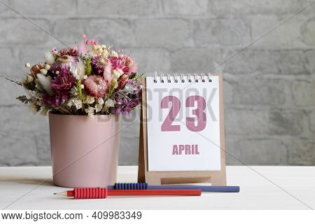 April 23. 23-th Day Of The Month, Calendar Date.a Delicate Bouquet Of Flowers In A Pink Vase, Two Pe