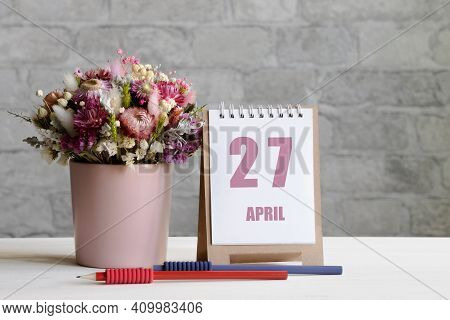 April 27. 27-th Day Of The Month, Calendar Date.a Delicate Bouquet Of Flowers In A Pink Vase, Two Pe