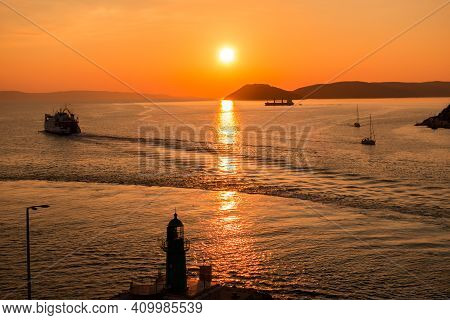 Sunset Over The Adriatic Sea And Its Boats Playing In The Reflections At The Entrance To The Port Of