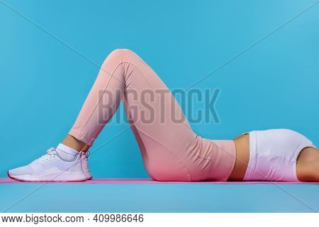 Woman Doing Exercises With Resistance Bands At Home. Cropped Shot Of A Young Fit Woman Exercising On
