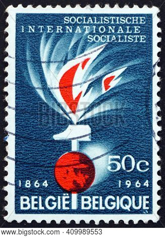 Belgium - Circa 1964: A Stamp Printed In Belgium Shows Flame, Hammer And Globe, Centenary Of The Fir