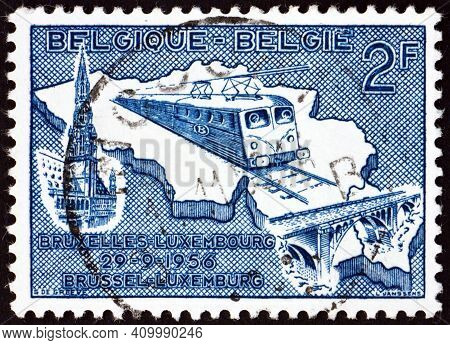 Belgium - Circa 1956: A Stamp Printed In Belgium Shows Train On Map Of Belgium And Luxembourg, Elect
