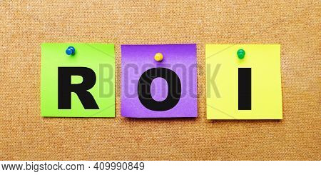 On A Beige Background, Multi-colored Stickers For Notes With The Word Roi