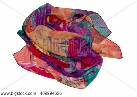 Silk Shawl Isolated. Closeup Of A Beautifully Folded Multicolored Silk Scarf Or Headscarf With A Pat