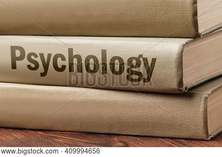 Psychology Book Concept On A Wooden Table For Learning