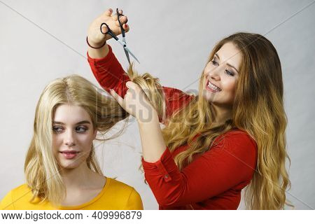 Hairstyle And Haircut. Young Female Barber Holding Scissors Tool Ready To Trimming Hair Her Friends.