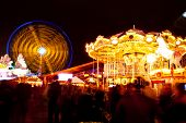 long exposure pictures of amusement park rides and wheels at night poster