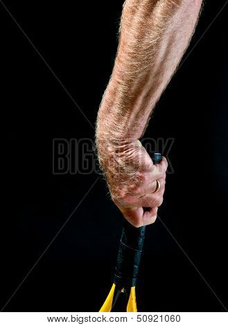 man's forearm with tennis racket