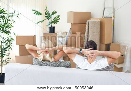 Couple resting in new home, break after hard work