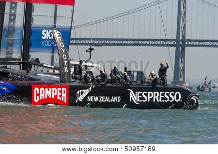 SAN FRANCISCO, CA - SEPTEMBER 12: The crew of Emirates Team New Zealand waves to the crowd after winning their America's Cup race in San Francisco, CA on September 12, 2013
