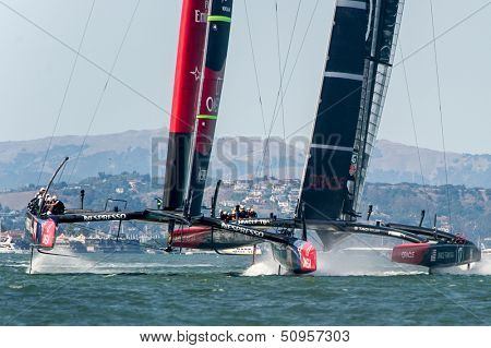 SAN FRANCISCO, CA - SEPTEMBER 12: Emirates Team New Zealand and Oracle Team USA compete in the America's Cup sailing races in San Francisco, CA on September 12, 2013