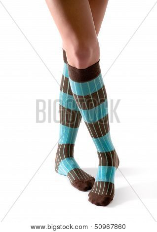 Young Woman Crossed Legs Posing With Turquoise Striped Socks