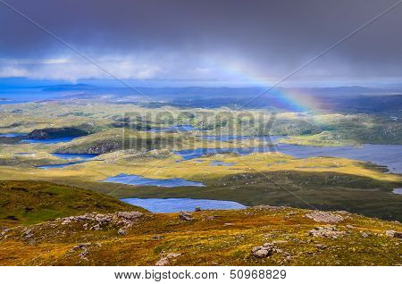 Scenic View Of Beautiful Lakes, Clouds And Rainbow In Inverpolly Area, Scotland