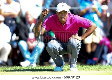 Sep 15, 2013; Lake Forest, IL, USA; Tiger Woods lines up a putt on the second green during the third round of the BMW Championship at Conway Farms Golf Club.