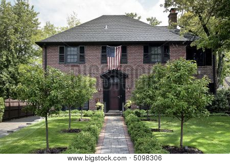 Brick Home With American Flag