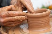 craftsman works in clay dishes outside handmade poster