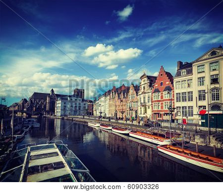 Vintage retro hipster style travel image of travel Belgium medieval european city town background with canal. Koperlei street, Ghent, Belgium