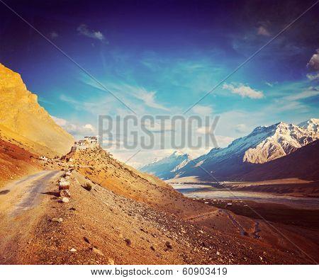 Vintage retro hipster style travel image of  road to Kee (Ki, Key) Monastery. Spiti Valley,  Himachal Pradesh, India poster