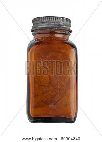 vintage brown glass spice bottle over white, clipping path