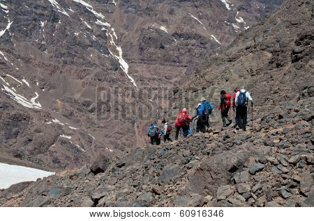Group Descending From Summit Of Mountain