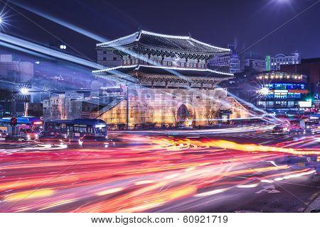 Seoul, South Korea cityscape and traffic Dongdaemun Gate. poster