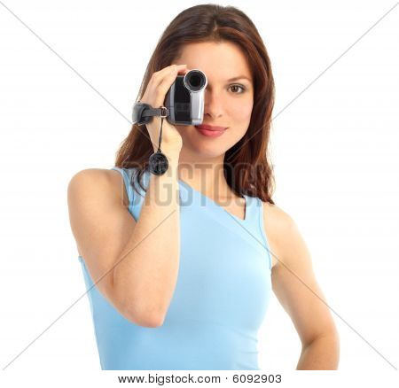 Young woman with video camera. Isolated over white background poster