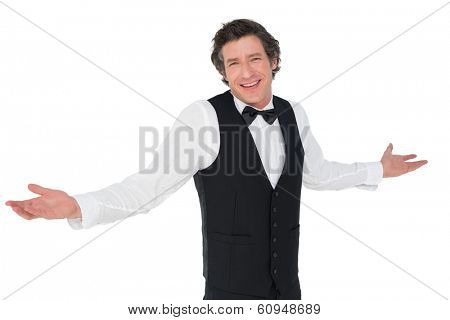 Portrait of smiling waiter shrugging isolated over white background