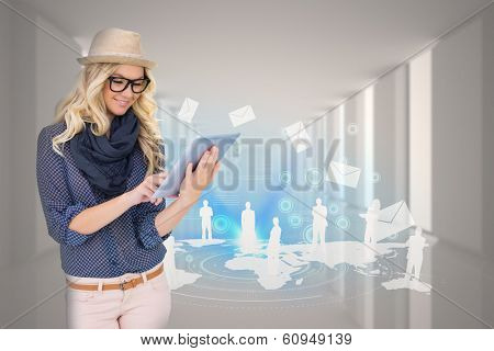 Digital composite of stylish blonde using tablet pc with email and map graphic poster