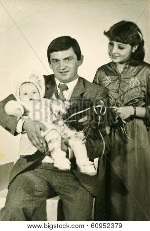 LODZ, POLAND,CIRCA SEVENTIES- vintage photo of godparents with a baby (christening)